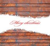 Vrolijke Kerstmisachtergrond met sneeuwvlokken en houten textuur Royalty-vrije Stock Foto's