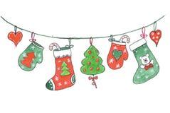 Vrolijke Kerstmisdecoratie die op een kabel hangen, die in waterverf trekken royalty-vrije stock fotografie