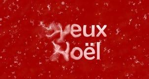 Vrolijke Kerstmistekst in de Franse draaien van Joyeux Noel aan stof van Stock Foto