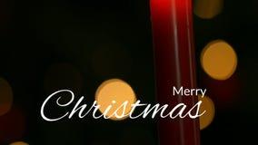 Vrolijke Kerstmistekst en brandende kaars stock footage