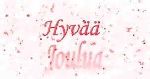 Vrolijke Kerstmistekst in Finse Hyvaa-jouluadraaien aan stof voor Stock Afbeeldingen