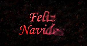 Vrolijke Kerstmistekst in Spaanse Feliz Navidad-draaien aan stof Fr Stock Foto
