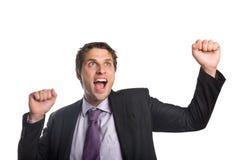 Vrolijke zakenman die aangezien hij omhoog kijkt toejuichen Stock Afbeelding