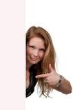 Vrouw achter een vertoning Stock Afbeeldingen