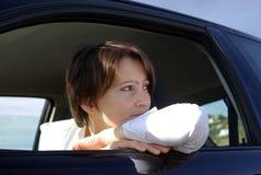 Vrouw in auto Stock Fotografie