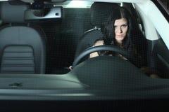 Vrouw in Auto Stock Foto