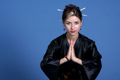Vrouw in Aziatisch gewaad Stock Foto