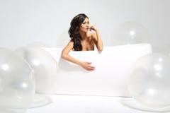 Vrouw in badkamers Stock Foto