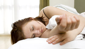 Vrouw in bed Royalty-vrije Stock Afbeelding