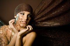 Vrouw in brons royalty-vrije stock fotografie