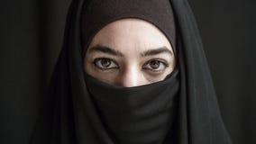 Vrouw in burka Stock Foto's