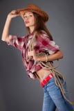 vrouw in cowboykleding Royalty-vrije Stock Foto's