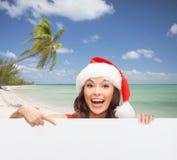 Vrouw in de hoed van de santahelper met lege witte raad royalty-vrije stock fotografie
