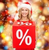 Vrouw in de hoed van de santahelper met rood verkoopteken Royalty-vrije Stock Afbeeldingen