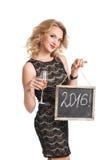 Vrouw in de holdingskaart van de Kerstmanhoed met rood woord van Royalty-vrije Stock Foto's
