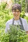 Vrouw in de tuin Royalty-vrije Stock Afbeelding