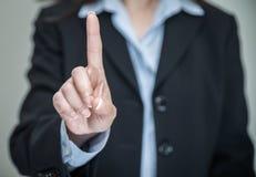 Vrouw die één vinger schudden Stock Fotografie