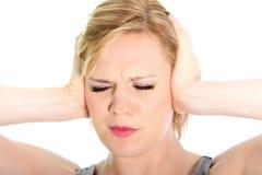 Vrouw die aan een hoofdpijn lijden Stock Foto's