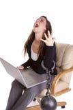 Vrouw die aan het werk wordt geketend Stock Foto
