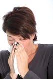 Vrouw die aan koude en griep lijdt royalty-vrije stock fotografie