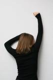 Vrouw die achteruitgaat stock fotografie