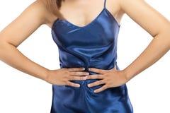 Vrouw die buikpijn, maagpijn of menstruele klemmen hebben royalty-vrije stock afbeelding