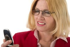 Vrouw die in Cellphone bekijkt Royalty-vrije Stock Fotografie
