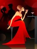 Vrouw die cocktail heeft bij de staaf Royalty-vrije Stock Afbeelding