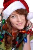 Vrouw die de Hoed van de Kerstman draagt Royalty-vrije Stock Afbeeldingen