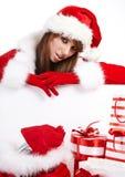 Vrouw die de kleren van de Kerstman draagt stock afbeelding