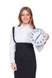Vrouw die de klok houdt en camera bekijkt Royalty-vrije Stock Foto