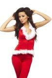 Vrouw die de sexy kleren van de Kerstman draagt Stock Foto's
