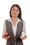 Het vergelijken van fruit, sinaasappel met geneeskunde Royalty-vrije Stock Afbeeldingen