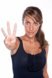 Vrouw die Drie Vingers steunt Royalty-vrije Stock Foto's