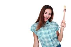 Vrouw die een borstel houden stock fotografie