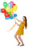 Vrouw die een bos van ballons houdt Stock Afbeeldingen