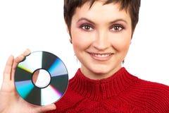 Vrouw die een CD houdt stock afbeeldingen