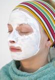 Vrouw die een gezichtsmasker draagt Royalty-vrije Stock Afbeelding