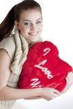 Vrouw die een hart houdt Stock Afbeelding