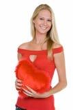 Vrouw die een hart houdt stock foto's