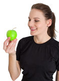 Vrouw die een het Groene Appel en Glimlachen houdt Stock Afbeelding