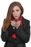 Vrouw die een kus blaast stock afbeeldingen
