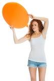 Vrouw die een leeg teken houden Stock Foto's