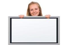 Vrouw die een lege raad houdt Stock Foto
