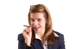 Vrouw die een Pen houdt Royalty-vrije Stock Afbeeldingen