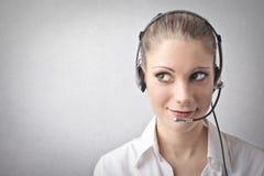 Vrouw die een telefoonexploitant zijn Stock Foto's