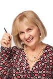 Vrouw die een zwart potlood houdt Royalty-vrije Stock Afbeelding