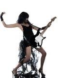 Vrouw die elektrische gitaarspeler speelt Stock Foto