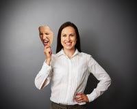 Vrouw die gek masker houden royalty-vrije stock foto