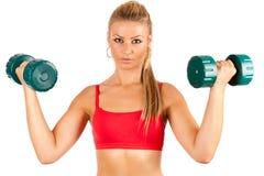 Vrouw die geschiktheid met gewichten doet Royalty-vrije Stock Foto's